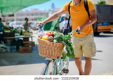 People buying fruits and vegetables. Summer outdoors farm market shopping background. Real purchasing selling natural healthy lifestyle candid closeup image.
