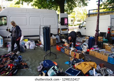People are buying second hand goods in public place on the street, Amsterdam, Netherlands, 20.09.2018