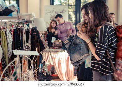 People buying and selling secondhand and handicrafts on indoor flea market. Thessaloniki, Central Macedonia, Greece. At Saturday 10 December 2016 on Flea Market Thessaloniki