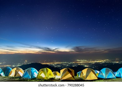 people camping on the mountain in morning too many tents with nice sky and stars