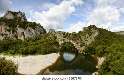 people canoeing, swimming and relaxing at the Pont d'Arc, Gorges de l'Ardeche, France