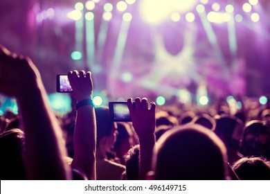 People capturing best memories on a mobile phone.