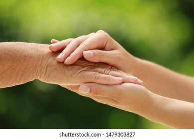 People, care and support. Giving helping hand concept