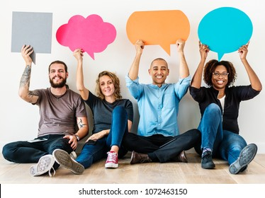 People carrying speech bubble icons