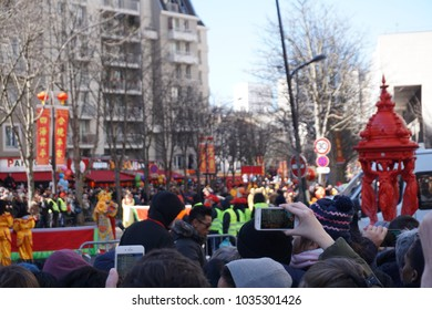 People celebrating Chinese new year, year of the dog, in Paris, France, 2018. There was a parade with some barongsai or lion dance with dragon barongsai and some chinese traditional cultures.