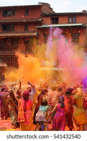 People celebrating holi festival in Nepal (or India)