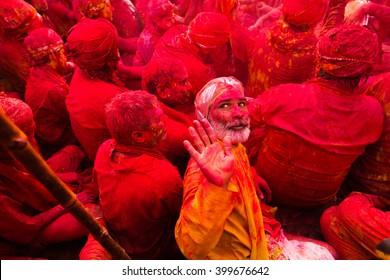 People celebrating Holi festival,Nandgaon,Uttar Pradesh,India - March 24,2016: Two celebrating Holi