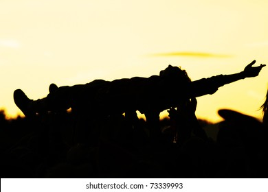 people celebrating on an open air silhouettes