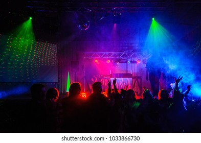 People Celebrating a Party, dancing, lots of colored light
