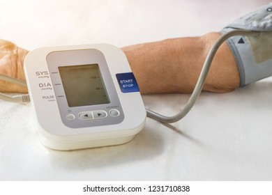 People are check blood pressure monitor and heart rate monitor with digital pressure. Healthcare and Medical concept
