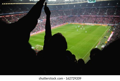 people cheering for a team