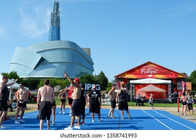 People and cheerleader in the forks park in front of Human right Canadian Museum during Summer. Winnipeg Manitoba Canada. July 8th 2017.
