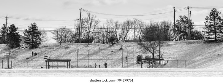 People and children sledding on hill and snow in Northern Kentucky local park urban exploration photography winter 2018 Black and white