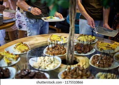 people choosing food at a banquet
