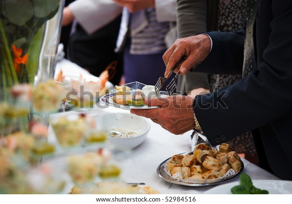 People choosing food from table on buffet party on wedding
