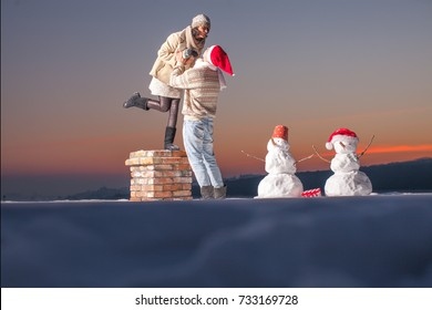 People, Christmas, holidays and new year concept. Happy family couple in winter clothes. Happy young couple hugging in winter weather. Freedom concept. Dream. Lifestyle. Happy day. Snowman. Sensual.