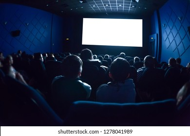 People in the cinema watching a movie