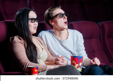 People in the cinema wearing 3d glasses and watching movie
