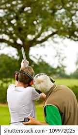 People clay shooting on the shooting range