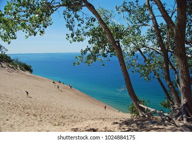 People climbing a dune in Sleeping Bear National Lakeshore.