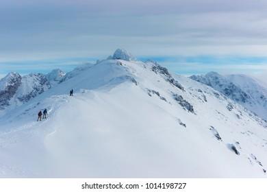 People climbing in Kasprowy Wierch in Zakopane on Tatras in winter.  Kasprowy Wierch is a mountain in Zakopane and the most popular ski area of Poland