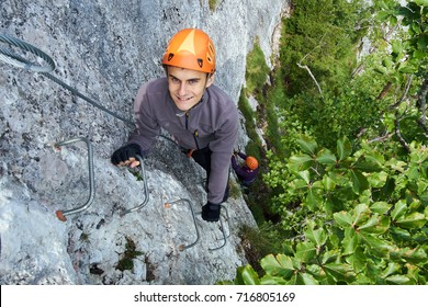 People climbing on a via ferrata route in the mountains