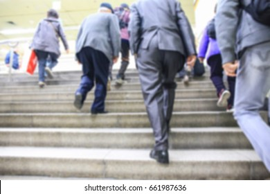 People is climbing the stairs to get out of the subway station. blur concept.