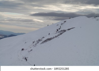 People climbing to the top in winter. Bieszczady Mountains