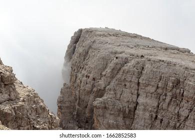 People climbing the Via Ferrata Sentiero delle Bocchette Alte in Brenta Dolomites mountains, Italy