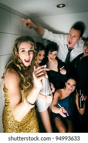 People in club and smoking a cigarette in the toilet and have lots of fun