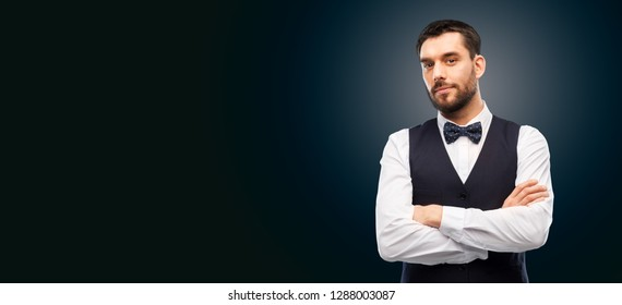 people concept - serious man in white shirt, waistcoat and bowtie over black background