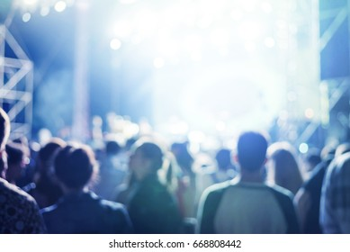 people at a concert, abstract blur background