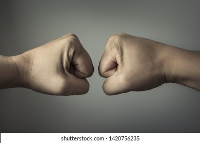 people conflict concept- clash of two fists coming together.