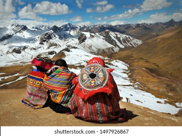 People contemplating the Andes in South America