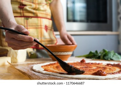 People cooking meat and grill. Food are vegeteble. People use chopsticks.