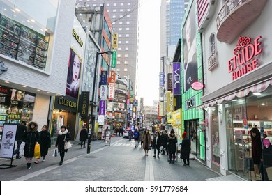 people and cosmetic shops at Myeong Dong taken in Seoul South Korea on 22 February 2017