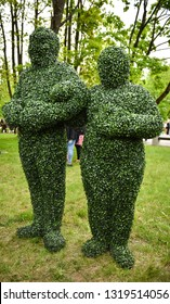 People in costumes evergreen tree. Concept of ecology and nature.