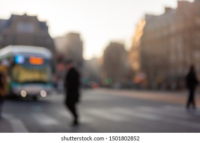 People cross the street in St.Germain district of Paris city.Picture shot out of focus intentionally and originally.