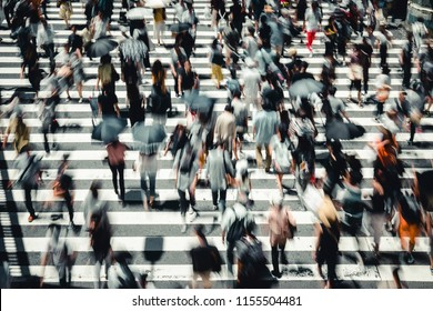 People crossing the crosswalk in Osaka, Japan