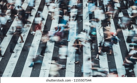 People crossing the crosswalk in Osaka, Japan