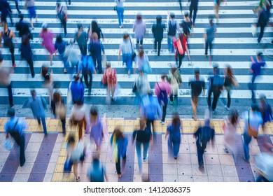 People crossing a pedestrian crossing