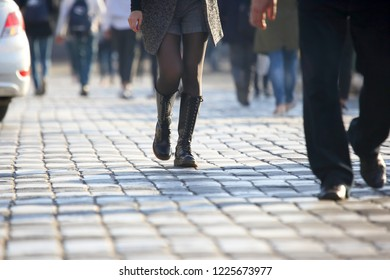 people crossing the road at a pedestrian crossing on the pavement