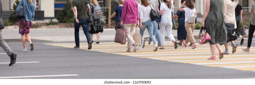 people crossing a road. pedestrian crossing. Zebra