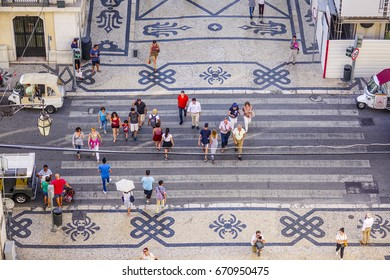 People crossing the street - aerial view from Augusta Street Arch - LISBON / PORTUGAL - JUNE 17, 2017