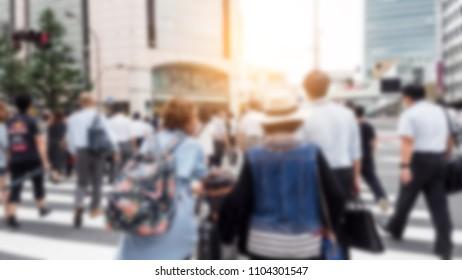 People crossing the street in japan.Blur background