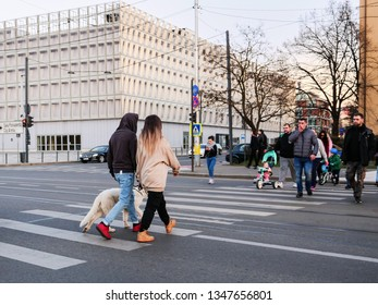 People crossing the street at the zebra crossing in Cluj-Napoca, Romania, March 23, 2019