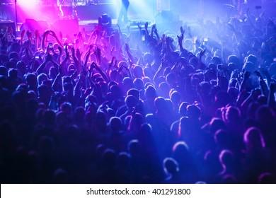People crowd in concert lights
