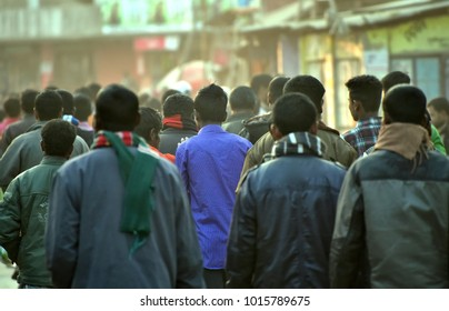 People in the crowd walking together on the street stock photograph