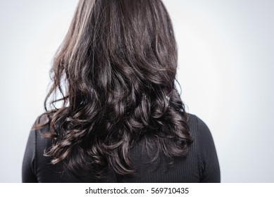 PEOPLE : Curly dark hair / Asian woman in black dress on white b
