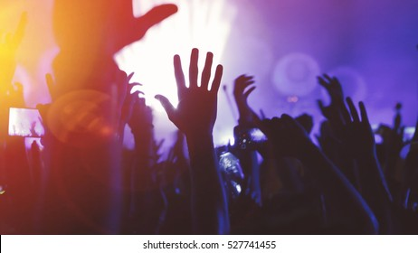 People dancing at concert and partying at festival